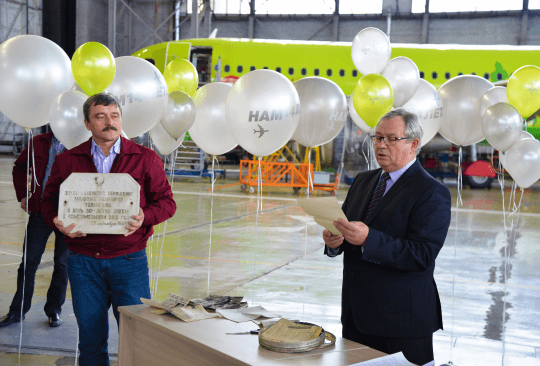 S7 Technics' personnel deposit a new 'Time Capsule' message  on its Novosibirsk facility's 14th birthday